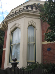 "Bay Window Detail of ""Clowance"", a Late Victorian Villa - Ballarat (raaen99) Tags: city windows brown house building tree brick home window leaves stone architecture facade fence garden painted name cement 19thcentury decoration australia victoria carving victoriana woodenfence villa historical residence housename nationaltrust roofline eaves gable ballarat goldrush picket 1893 redbrick parapet ornamentation nineteenthcentury picketfence 1890s 1892 sashwindow countryvictoria baywindow gardenfence domesticarchitecture victorianera heritagelisted newelpost clowance gingerbreading goldrushera brickandstone renderedbrick cementrender provincialvictoria boomstyle battlementedparapet architecturallydesigned boomstylearchitecture hippedgable clowancehouse isaiahpearce wegribble"