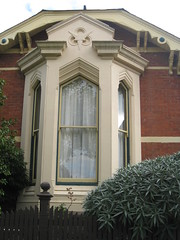 "Bay Window Detail of ""Clowance"", a Late Victorian Villa - Ballarat (raaen99) Tags: city windows brown house building brick home window leaves stone architecture facade fence garden painted name cement 19thcentury decoration australia victoria carving victoriana woodenfence villa historical residence housename nationaltrust roofline pediment eaves gable ballarat goldrush picket 1893 redbrick ornamentation nineteenthcentury picketfence 1890s 1892 sashwindow countryvictoria baywindow gardenfence domesticarchitecture victorianera heritagelisted newelpost clowance gingerbreading goldrushera brickandstone renderedbrick cementrender provincialvictoria boomstyle architecturallydesigned boomstylearchitecture hippedgable raisedpediment clowancehouse isaiahpearce wegribble"