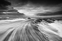 Grainy Rush (Tim Donnelly (TimboDon)) Tags: ocean sea blackandwhite bw seascape canon flow australia rush nsw hit
