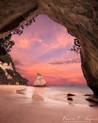 Cathedral Cove (Pawel Papis Photography) Tags: ocean travel sunset red sea newzealand summer sky cliff cloud seascape tree beach window nature water beautiful beauty rock stone sunrise landscape island dawn bay coast amazing twilight sand surf arch view cathedral natural cove tide shoreline scenic wave formation coastal shore nz land destination coastline cave kiwi peninsula attraction coromandel australasia tehoho