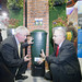 NI Water's Chairman Sean Hogan shows Minister Kennedy how to be waterwise around the garden by installing a waterbutt