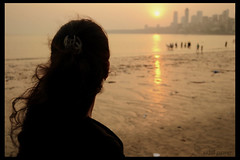 a city of dreams, a city of hope, a city of God! (Akhil Pawar) Tags: sunset woman girl silhouette mumbai chowpatty girgaum