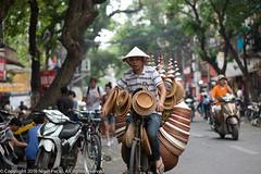 Hat Man on a Bicycle (Pexpix) Tags: bicycle hanoi nikkoraf85mmf14d nikondf outdoor street vietnam hni