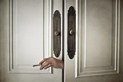 the closet (Iris Syzlack) Tags: white sepia closet hand cigarette