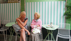 IMG_8869 (jimj0will) Tags: chat natter ladies pink green people street chairs cafe stripes
