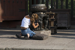 Girl at (artistic) work (Igor Voller) Tags: summer sculpture white hot girl japan hair handy bag temple back foto phone top sommer picture jeans  nara taking              frulein