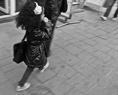 Thumb sucking, and the father drags her along. (Bas Tadema) Tags: street camera city blackandwhite bw girl dark hair bag walking photography rotterdam holding hands fotografie hand skin little nederland olympus thumb curled vader tas sucking lopen zwart wit meisje fathers straat clinging haar duim huid zuigen strik krulletjes getinte duimend