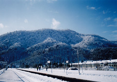 Yubari Train Station after a Winter Storm (sjrankin) Tags: snow japan clouds edited hills trainstation yubari 3january1997