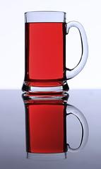 Liquid in Glass (heytherejustine) Tags: lighting red beer glass field photoshop canon dark studio rebel high key bright wine juice commercial mug product liquid tabletop strobe lightroom cs5 t1i