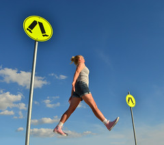 Beware of Zebra (phunnyfotos) Tags: blue sky woman signs girl sign walking jump jumping nikon skies walk australia bluesky victoria vic leap leaping zebracrossing pedestriancrossing euroa d5100 nikond5100 phunnyfotos