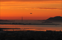 Golden Gate Blimp (LifeLover4) Tags: sanfrancisco sunset canon oakland treasureisland zeppelin goldengatebridge blimp airship alcatraz emeryville 75th dirigible ggb ef70300mmf456isusm 550d t2i parkpic lifelover4 stickneydesign ggb75