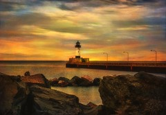 Lighthouse at Sunset (LynnF1024) Tags: sunset sky lighthouse lake texture water photoshop landscape aperture mn duluth lakesuperior canalpark nikond90 afsdxzoomnikkor1855mmf3556gedii magicunicornverybest lynnf1024 aperturehdrefexpro aperturecolorefexpro