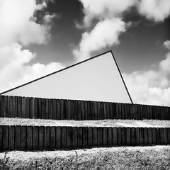 Triangle [Explored] (Thomas Leth-Olsen) Tags: bw architecture clouds fence triangle geometry woodenfence modernarchitecture lorient urbanabstract constrasty
