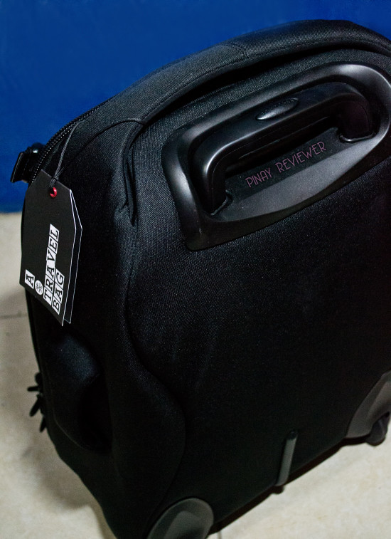 The retractable trolley handle is integrated into the luggage bag