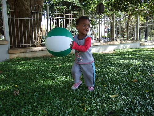 Thanda playing with a beach ball