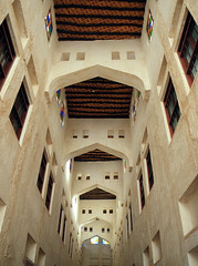 Looking Up (Kombizz) Tags: red building architecture design colorful pretty arch gulf decorative curves middleeast logs arches holes ceiling lookingup commercial archway twigs bazzar narrow straws doha qatar persiangulf parallellines palmleaves olddesign 4808 diamondshape hasir khalijfars kombizz haseer khaleejfars