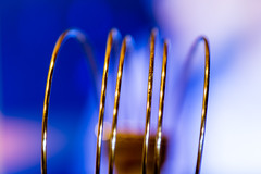 Arcing Wires (Dalliance with Light) Tags: blue abstract macro bokeh steel curves wires arcs macromonday