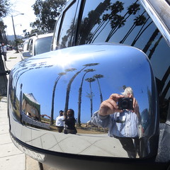 Easter Selfie With Palm Trees and Parked Cars (Viejito) Tags: cabrilloblvd santabarbara california usa unitedstates amerika amérique américa beach plage waterfront canon s100 canons100 powershot geotagged geo:lat=34411778 geo:lon=119688878 stearnswharf johnpeckstearns pacificocean america palm trees suv cars automobiles mirror turn signal van sidewalk curb sun light tshirt picnic window tree bird droppings display women girls young lady men distorted view terabyte 500x500 square kerb me selfie reflection