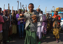 Oromo man with a kalashnikov during a wedding celebration, Oromo, Sambate, Ethiopia (Eric Lafforgue) Tags: africa wedding people color men horizontal religious outdoors togetherness sticks day african muslim islam joy marriage happiness celebrations weapon canes guest ethiopia cheerful adults groupofpeople celebrating islamic weddingceremony developingcountry indigenous ethnicity traditionalculture hornofafrica happily eastafrica kalashnikov abyssinia worldculture realpeople lookingatcamera onlymen oromo cheerfully traditionalceremony lifeevent modernityandtradition sambate ethio161203