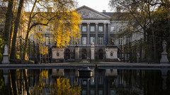 Project 366 - 124/366: Morning reflection (sdejongh) Tags: park street city morning light shadow brussels urban reflection building tree water leaves architecture contrast fence project pond branches royal parliament belgian federal folliage foutain sharpness 366 124366