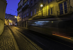 full throttle tram (Blende1.8) Tags: tram strasenbahn strassenbahn lissabon lisboa lisbon speed street strase bluehour blauestunde pflasterstein nikon d750 nikkor 1635mm wideangle carstenheyer night nacht abend evening light licht lightstream bewegung movement geschwindigkeit bergauf