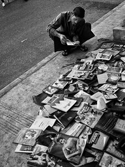 The Eternal Light of Books (Feldore) Tags: street man reading book candid yangon burma stall books olympus bookshop burmese mchugh piles crouching scattered em1 immersed 1240mm feldore