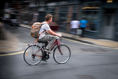 Happy cyclist making his way through York, England. (James- Burke) Tags: york yorkshire panning cyclist riding commuting travel movement action bike sport vehicle