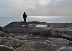 On the rocks (AstridWestvang) Tags: sea sky man puddle rocks larvik ula svaberg