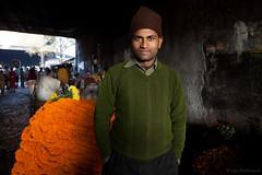 Flowermarket in Kolkata (Lars Pohlmann) Tags: travel flowers portrait orange india photography asia flickr slideshow kolkata canonef2470mmf28lusm calcutta environmentalportrait