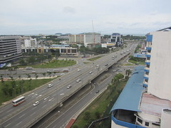 Bird's Eye View Of Karamunsing Flyover (thienzieyung) Tags: city morning travel trees sea white streets cars water buses lines islands moving construction highway view traffic cloudy streetlights many horizon curves over places cranes vehicles busy malaysia arrows kotakinabalu cbd roads sabah turning birdseye lanes bustling jalantuaran karamunsing thienzieyung
