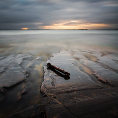 Washed up (- David Olsson -) Tags: longexposure sunset lake seascape colour nature wet water clouds square landscape evening nikon rocks branch cloudy sweden tripod may windy cliffs le 1750 late tamron limb squarecrop vänern 2012 dx hammarö värmland ndfilter lakescape smoothwater smoothsky 1750mm d5000 takene atouchoforange davidolsson hammarösydspets nd500 lightcraftworkshop 2exposuremanualblend