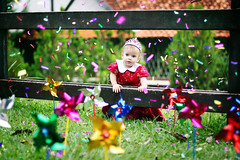 Birthday Princess (AnnuskA  - AnnA Theodora) Tags: birthday red portrait baby tiara fence kid colorful dress princess confetti lovely pinwheels catavento
