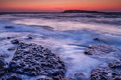 Moelfre (i.m.j.) Tags: longexposure sea beach wet rock wales island dawn shiny waves cymru windy carreg 430 mr anglesey gwynt canon1022mm ynysmn imj moelfre easterly tonnau symud gwawrio canon7d