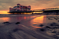 Grand Pier at Weston (Explore Front Page) (martinturner) Tags: new longexposure pink light sunset sea orange sun seaweed beach lights pier sand neon waves purple grand somerset splash westonsupermare weston rebuilt wsm martinturner