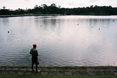 fishing (jamiehladky) Tags: lake fish water 35mm fishing fisherman singapore waiting olympus sing fisher catch mm 35 buoys buoy spore macritchie om2n jamiehladky hladky rservior