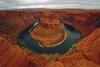 Turn around, Horseshoe Bend, Arizona (Robyn Hooz) Tags: red arizona horse clouds canon river shoe eos colorado nuvole bend awesome fiume sigma wideangle cliffs page splendida rosso grandangolo cavallo colline sabbia ferro curva 600d 1020exhsm