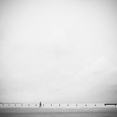 Am Strand (One_Penny) Tags: travel sky people blackandwhite usa white chicago man black beach composition america square person photography pier illinois sand alone unitedstates bright walk space minimal shore squareformat highkey emptyspace canon6d