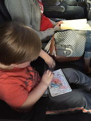 "Paul Colors with Mommy on the Airplane to Dallas • <a style=""font-size:0.8em;"" href=""http://www.flickr.com/photos/109120354@N07/27244234233/"" target=""_blank"">View on Flickr</a>"
