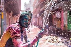Holi Shower (Jakob Kolar) Tags: street travel family portrait india men water colors face festival asia colours father religion celebration hindu indien colorfestival mathura holifestival uttarpradesh festivalofcolours coloredface