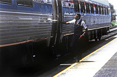 Amtrak northbound Silver Star with coach and car attendant seen at the station platform in Lakeland, Florida, August 1991 (alcomike43) Tags: old city color classic station vintage photo coach downtown platform slide trains historic amtrak photograph depot railroads csx passengertrains lakelandflorida passengercars amtraksilverstar carattendant amfleetequipment