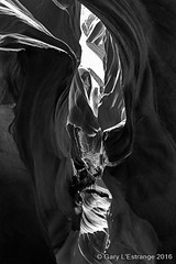 Antelope Canyon 6 (garylestrangephotography) Tags: light arizona blackandwhite usa white abstract black texture tourism monochrome rock stone dark landscape grey mono blackwhite nationalpark pattern outdoor indian surreal wave monotone tourist canyon serene slot touristattraction reservation antelopecanyon navajonation touristdestination touristlocation garylestrangephotography
