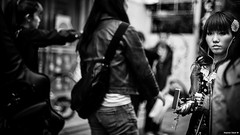 Wife by Two Thousand (Stephan Geyer) Tags: street trip flowers bw white black classic girl mobile japan lady canon walking eos japanese 50mm tokyo funny dof phone bokeh f14 candid young hairdo harajuku headphones 5d usm flickrd ef 5014
