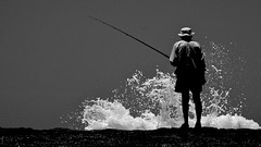 The Old Man and the Sea - waiting for a bite. (Andy Burton Oz) Tags: blackandwhite bw fish monochrome fishing fisherman australia pacificocean nsw iphoto rod hastings tasmansea pointperpendicular fishingrod angler angling rockfishing camdenhead afsvrmicronikkor105mmf28gifed nikond40 dunbogan aperture323