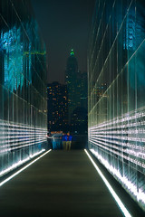Touching the Wall (SunnyDazzled) Tags: longexposure newyork history night newjersey memorial manhattan 911 motionblur sept11 tribute names visitors legacy groundzero engraved victims touching libertystatepark survivors emptysky