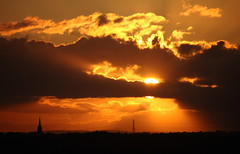 Sunset from Sandal Castle no 3 (Anita K Firth) Tags: sunset orange brown sun silhouette clouds evening view pylon spire cables electricity wakefield goingdown silverlining sandalcastle may2012 ossettchurch