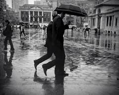"""Synching in the Rain"" (Sion Fullana) Tags: nyc urban blackandwhite bw newyork reflection blancoynegro rain umbrella lluvia suits citylife streetshots streetphotography reflejo characters cinematic unionsquare paraguas allrightsreserved decisivemoment newyorkers newyorklife businessmen iphone businesssuits cellphoneimages urbanshots urbannewyork mobilephotography decisivemoments malefriends synchronizedwalk iphoneography iphoneographer sionfullana editedanduploadedoniphone hipstamatic hipstamaticapp throughthelensofaniphone iphone4s mobilephotogroup synchingintherain"