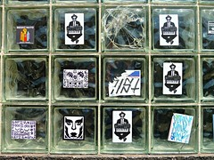 Logan Squares (silverfuture) Tags: broken label stickers x slap smashed logansquare cracked glassblock 2012 ochi hollywoodsquares slaptags sevenist 7ist chicagospring uspsprioritymail espir qfk occupychicago roguemoog resistnato hornymomsrock chicagospringorg natoprotestorg