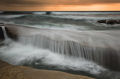 under siege (Andy Kennelly) Tags: ocean california sea wild painterly motion beach la waterfall high sandstone rocks long exposure pacific crash tide under formation layers rough spill cascade rugged siege jolla pounding