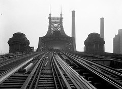 Grim, gothic and industrial view of the Queensboro Bridge and two massive smokestacks, showing the reconstruction of its train tracks looking east to Queens.  New York. 1930. (wavz13) Tags: blackandwhite industry industrial gritty oldphotographs desolate oldphotos oldnewyork vintagephotos 59thstreetbridge oldbridge 59thstbridge oldphotography oldfactory vintagephotographs urbanindustry oldindustry industrialage vintagephotography oldfactories oldrailroad oldbridges antiquebridge vintagenewyork oldqueens industrialbridge vintagefactory oldrailroads antiquerailroad vintagebridge 19thcenturyindustry vintageindustry 1930sphotography vintagemanhattan 1930snewyork vintagebridges industrialbridges vintagequeens old59thstbridge 1930sphotos antiquenewyork 1930smanhattan vintagefactories 20thcenturyindustry antiquemanhattan antiquerailroads antiqueindustry 1930squeens antiquebridges vintagequeensborobridge oldqueensborobridge 1930squeensborobridge vintage59thstreetbridge old59thstreetbridge 1930s59thstreetbridge vintage59thstbridge 1930s59thstbridge 1930sphotographs