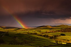 Rainbow and Sunlight, Yorkshire Dales (Explored) (Steve Thompson images) Tags: sun storm rain landscape rainbow yorkshire barns valley fields farms walls yorkshiredales wharfe austwick polarisingfilter canon24105l thedales ndgradfilter canon5dmark2